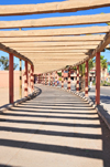 Laâyoune / El Aaiun, Saguia el-Hamra, Western Sahara: probably the longest pergola in the world - beams and shadows - Place Oum Saad - photo by M.Torres