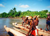 West Papua / Irian Jaya - Syuru village: dugout canoes and crew (photo by G.Frysinger)