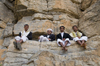 Kohlan / Quhlan, Qohlan, Hajjah governorate, Yemen: local men gathered on rocks - cliff face - photo by J.Pemberton