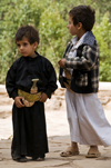 Wadi Dhahr, Al-Mahwit Governorate, Yemen: young boys with Jambiyya daggers - photo by J.Pemberton