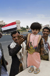Sana'a / Sanaa, Yemen: young boy with a flag, celebrating national day, October 14th - photo by J.Pemberton