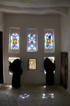 Wadi Dhahr, Al-Mahwit Governorate, Yemen: women looking out the windows of Dar al-Hajar Palace - stained-glass takhrim windows - photo by J.Pemberton