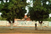 Zambia - Livingstone: hanging out - walls with ads - photo by J.Banks