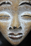 Lusaka, Zambia: African mask with tranquil expression - photo by M.Torres