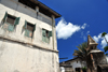 Stone Town, Zanzibar, Tanzania: building and wall on Mizingani Road - windows with shutters - photo by M.Torres