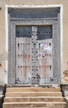 Stone Town, Zanzibar, Tanzania: old hand-carved ornamented wooden door - Mizingani Road - photo by M.Torres