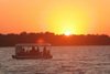 Zambesi river, Matabeleland North province, Zimbabwe: river tour at sunset - photo by R.Eime
