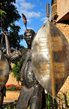 Victoria Falls, Matabeleland North, Zimbabwe: Kingdom Hotel - The Kingdom At Victoria Falls - sculpture of an African warrior with spear and shield - photo by M.Torres