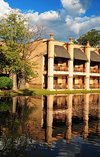 Victoria Falls, Matabeleland North, Zimbabwe: Kingdom Hotel - The Kingdom At Victoria Falls - pond side rooms - baobab trees - the architecture on the ancient Kingdom of Munhumutapa - photo by M.Torres