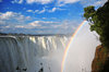 Victoria Falls, Matabeleland North, Zimbabwe: Victoria Falls aka Mosi-oa-Tunya - the Zambezi river drops from the basalt plateau - rainbow and spray - Victoria Falls National Park - UNESCO World Heritage Site - photo by M.Torres