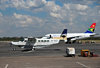 Victoria Falls, Matabeleland North, Zimbabwe: Victoria Falls Airport - Solenta Aviation Cessna 208B Grand Caravan ZS-SLO cn 208B0485 and South African Airways Airbus A319,  ZS-SFG cn 2326 - photo by M.Torres