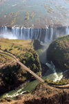 Victoria Falls - Mosi-oa-tunya, Matabeleland North province, Zimbabwe: the falls and the Zambesi bridge from the air - photo by R.Eime